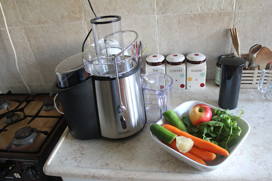 new juicer and apple, carrot, spinach juice